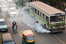 Smoke comes out of a public bus waiting at a traffic light in New Delhi, India, on Saturday, Nov. 26, 2011. Morgan Stanley reduced its growth estimate for India to 7 percent from 7.2 percent earlier for the year ending March 31, according to an e-mailed statement today. Photographer: Prashanth Vishwanathan/Bloomberg via Getty Images